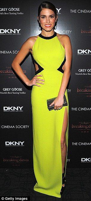 Nikki Reed in vibrant green cutaway Michael Kors dress