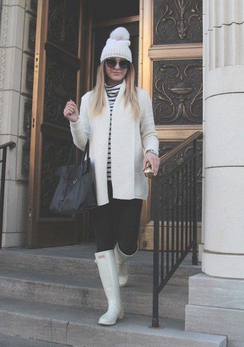 Woman Wearing White Hunter Boots