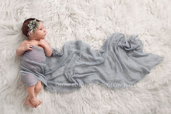 Unique way to wrap a newborn - or not quite wrap as the case may be.  Love it.