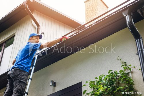 Man On Ladder Cleaning House Gutter From Leaves And Dirt In 2020 Cleaning Gutters Gutter Maintenance Gutters