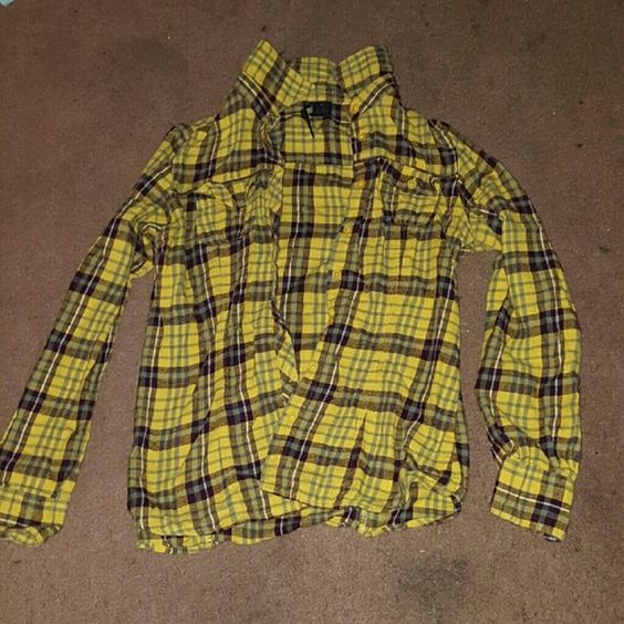 Plade shirt Cute plade shirt goes great with anything. Colors are yellow brown green. Is in great condition just never wear it anymore. Tops Button Down Shirts