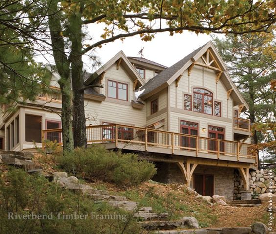 This home's exterior highlights the beauty and uniqueness timber frame can bring to your traditional style home.