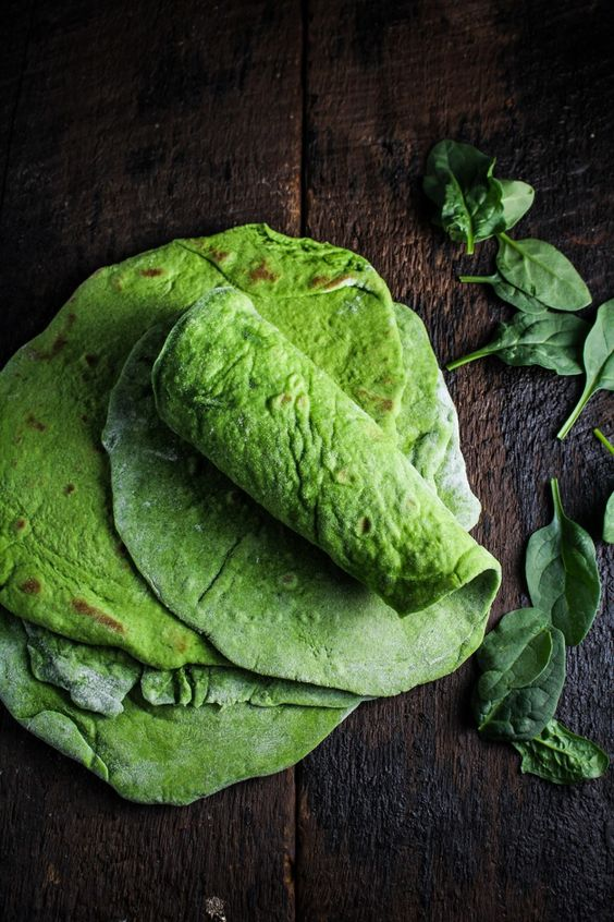 Homemade Spinach Wraps 3 c. flour 1 1/2 tsp baking powder 1 tsp salt 4 TBS vegetable oil 4 oz. spinach 3/4 c. milk, warmed in the microwave or on the stovetop