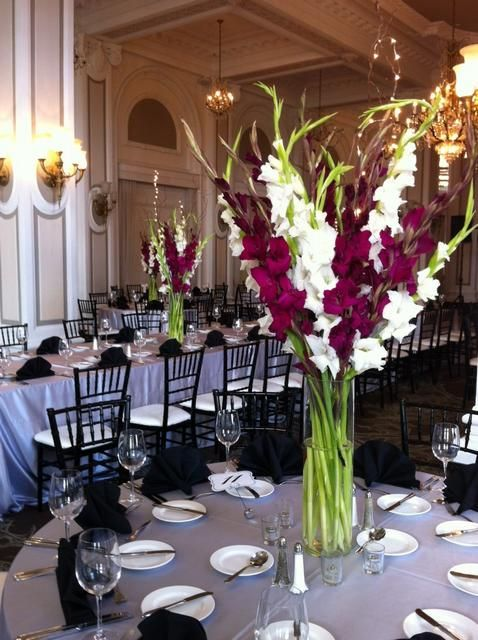 Simple Centerpiece could be used for asile decor as well. Gladiolus in soft pink/white with gold branches