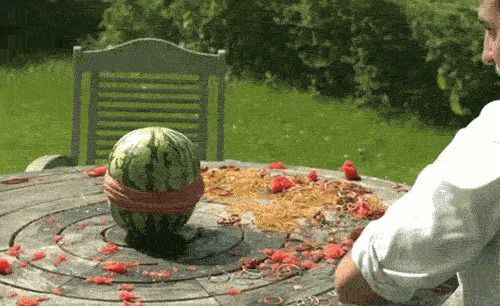 Watermelon exploded by the squeeze of a hundred rubber bands