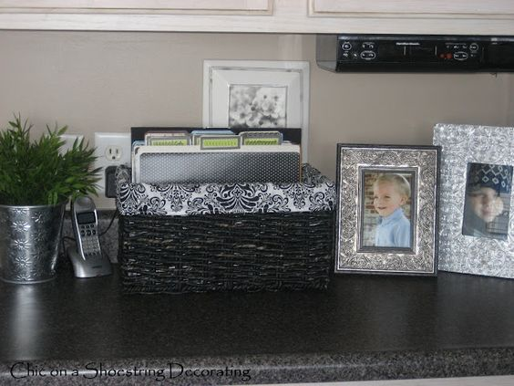 Organize our paper clutter in the kitchen, where it always ends up all over the counter!: