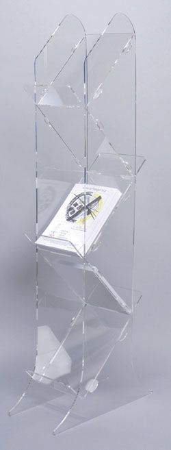 I really like the style of this magazine stand, i think its minimal looking but chic at the same time because of its transparency. I think that the stand will work well to display the magazine because it will really stand out.
