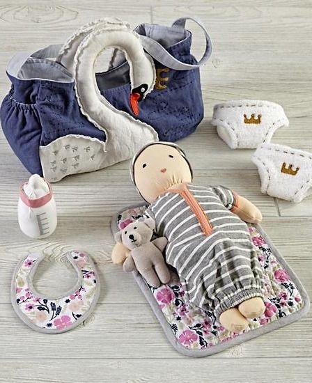 Dolls are a big responsibility and deserve the utmost care. This doll diaper bag has all the essentials for you kids' dolls, included a bottle, diapers, bib and more.