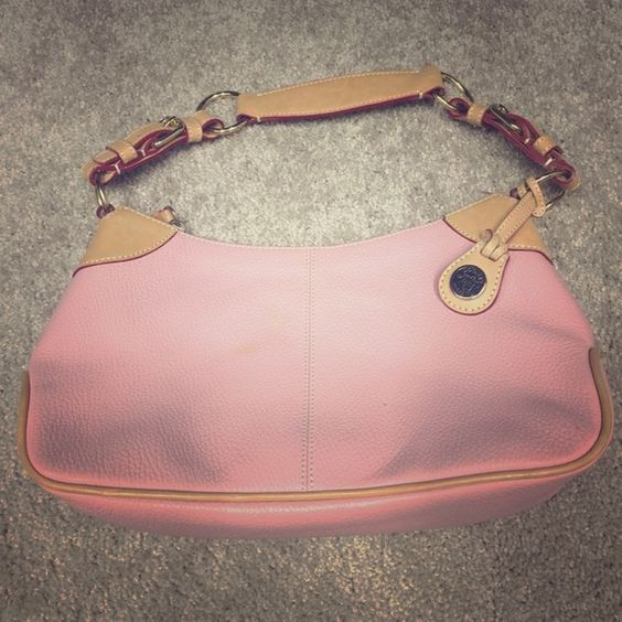 Dooney & Bourke Small O-Ring Slouch Bag Pink This is pebbled pink leather. It has never been used but something spilled on it in storage. I am taking it to a leather shop to have cleaned. Will post new pictures soon. Dooney & Bourke Bags Mini Bags