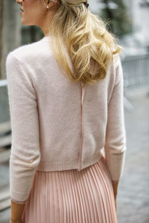 Soft and chic layers of pink and a cardigan put on backwards: