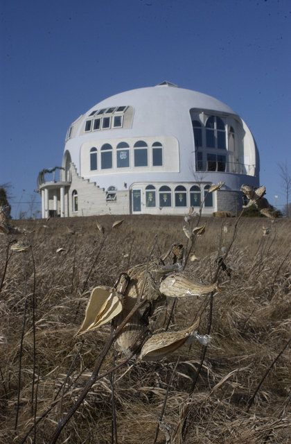 The Disappearing Dome — This a Monolithic Dome with a diameter of 55 feet and three stories. The Disappearing Dome overlooks Lake Michigan.: