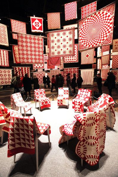 """People visit the """"Infinite Variety: Three Centuries of Red and White Quilts"""" show presented by the American Folk Art Museum at the Park Avenue Armory on March 30, 2011 in New York City. The 650 American quilts from three centuries are coverings created mostly by anonymous quilters in the 19th century.  It is the single largest quilt exhibition ever displayed in one venue in New York."""