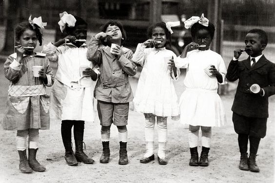 SCHOOL: 1910. First graders from the Miner Normal School in Washington, D.C. brushing their teeth. Their teacher was Ada Hand. Personal hygiene - teeth brushing, use of tissues, fingernail clipping and cleaning - were curricular exercises.