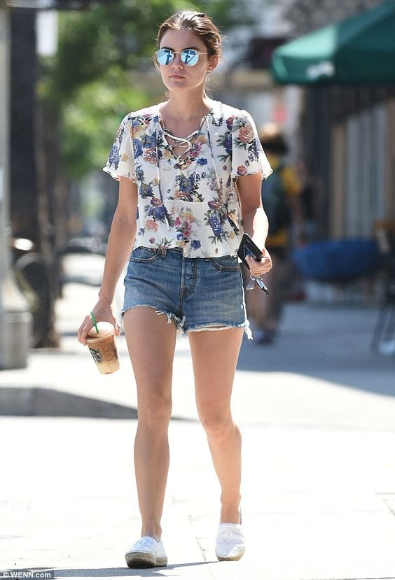Pretty as a petal! Lucy Hale sported a breezy, lace-up white blouse with a fun, floral print as she stepped out in Los Angeles on Monday. She finished off the look with chic Chanel espadrilles