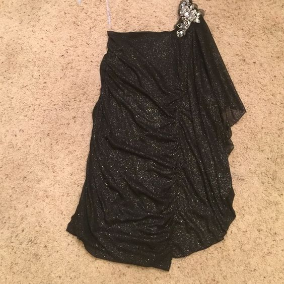 Black sparkly homecoming dress Short black and sparkly homecoming dress with beaded shoulder. One shoulder with a draped sleeve Worn twice. Size small. Emerald sundae Dresses One Shoulder