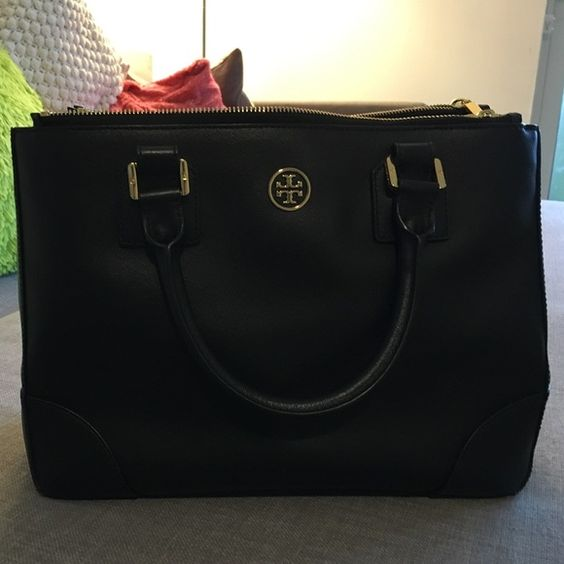 Tory Burch large double zip tote Black bag with shoulder strap. Double zippers. One zipper pocket and two open pockets in the middle section. In great condition. Used less than one year. Tory Burch Bags Totes