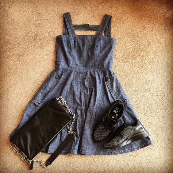 Denim dress with open back and leather clutch that folds open into a bigger bag Made In Cape Town  And for all day walking when travelling  Nike sneakers