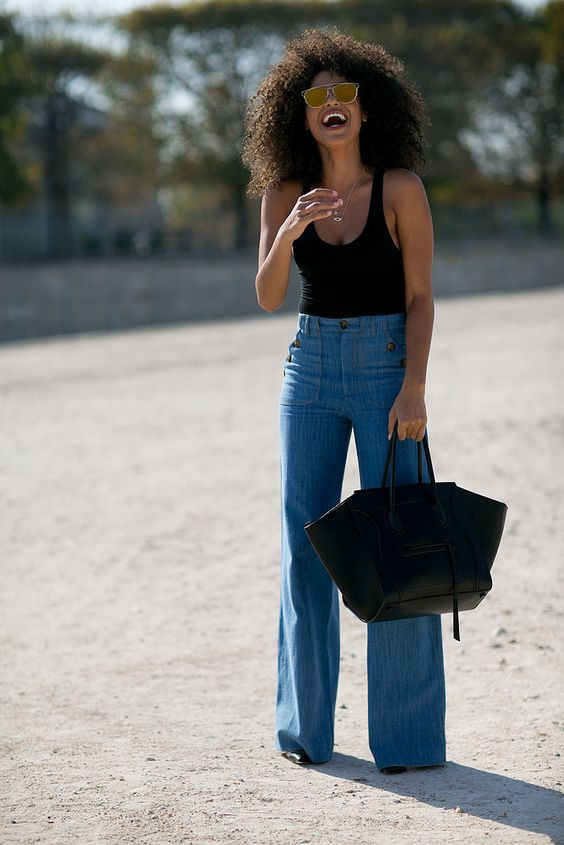 Flared jeans and a structured leather tote