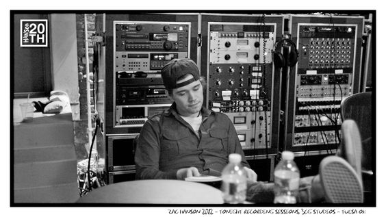 "Photo 301 of 365  Zac Hanson 2012 - Tonight Recording Sessions, 3CG Studios - Tulsa OK	    Zac is rocking a backwards hat in this quiet moment in the studio while recording an album contender, the song ""Tonight"". Zac is working on some kind of notes here, what is on his notebook page? (Be creative)    #Hanson #Hanson20th"