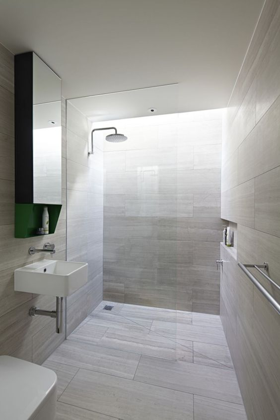 floor to ceiling stone walls combined with recessed niche for concealing shower supplies ceiling wall shower lighting
