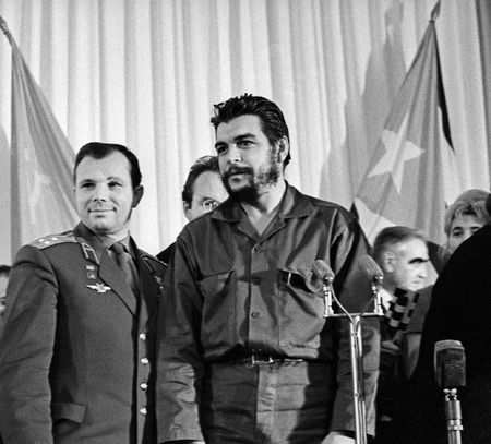 Yuri Gagarin meets Che Guevara, in Moscow, Russia, in 1964. Soviet cosmonaut Yuri Gagarin (left, 1934-1968) became the first human in space, orbiting the Earth in the Vostok 1 spacecraft on 12 April 1961. Following this historic spaceflight, Gagarin became a hero in the Soviet Union and famous worldwide, undertaking many tours and official duties. Ernesto 'Che' Guevara (right, 1928-1967) was a Marxist revolutionary and guerilla fighter who fought in the Cuban Revolution