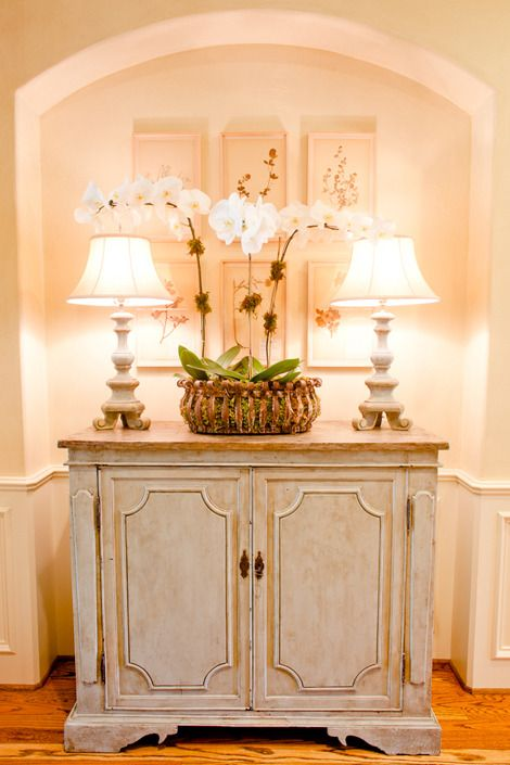 By adding some French country antiques, the whole concept of mixing the old with the new comes to life. The home begins to tell a story and become interesting.