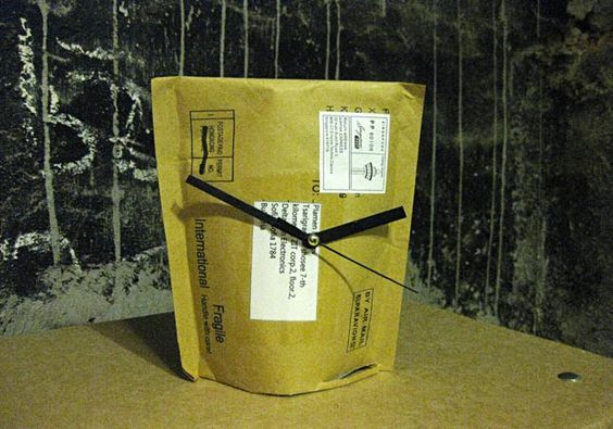 Okay, now that's just cool. A clock made from a recycled mailer.