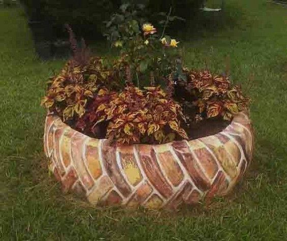 Neat idea with old tire painted to look like bricks - Painted tires for gardens ...