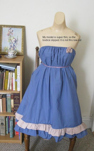 A repurposed bedsheet (sized full) that becomes a dress- very easy!  The only sewing is the seam up the back and the ruffles on the bottom (a simple hem).