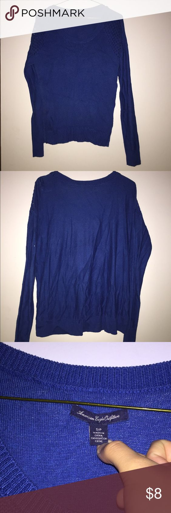 American Eagle Blue Sweater Size Small Blue AE sweater, size small. Shoulders have a design so theres spaces between stitches so they're see through. Can post model photos upon request. Barely worn, in perfect condition. Not tight fitting but not loose either. American Eagle Outfitters Sweaters Crew & Scoop Necks