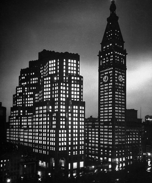 The new Metropolitan Life Insurance Company North Building and the 1909 Metropolitan Life Insurance Company Tower at night, Madison Square, New York City.  Photo by Herbert Gehr. 1947