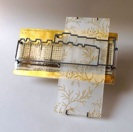 Jana Machatova Brooch: Where are you from?, 2014 Plexiglass, silver, paper in laminated plastic, gold foil 11 x 10 x 1.5 cm From collection - 'Where are you from?':