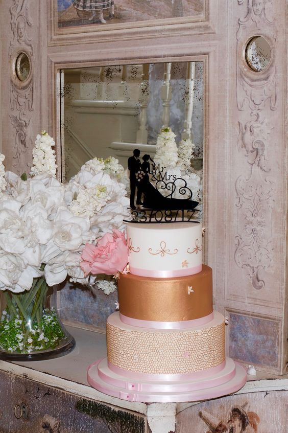 A luxurious gold wedding cake deserves a beautiful wedding cake topper. View our full selection at www.yourperfectfinish.com