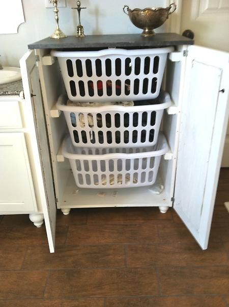Instead of a huge pile building up in the corner of the room: a laundry basket dresser  BRILLIANT!!
