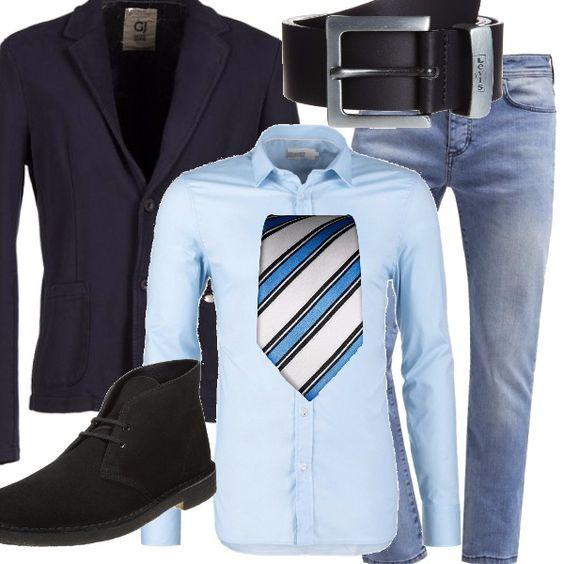 In jeans in ufficio, abbinandoli alla camicia di taglio classico da indossare con una cravatta a righe, insieme alla giacca elegante, ma di taglio sportivo. Gli accessori sono neri: le scarpe stringate e la cintura.