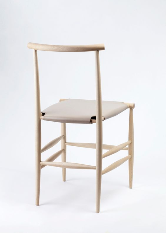 """Inspired by the natural reduction of the skeletal system, the Pelleossa chair's name literally translates to """"skin and bones."""" The handcrafted wood and stretched fabric chair combines the best of traditional workmanship and modern production efficiency."""