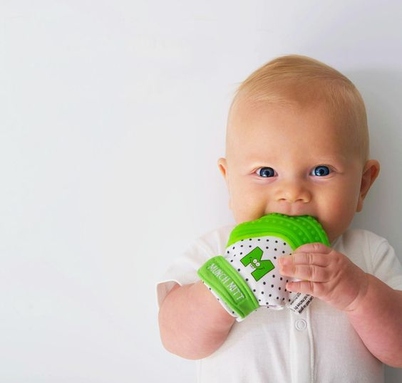 Munch Mitt A textured flexible silicone surface provides soothing teething relief.  Easy hand to mouth access for baby. Secure adjustable strap. Protects baby's hands from excess saliva and chewing. Interchangeable - can be worn on whichever hand baby prefers. Recommended ages: 3 months-12 months