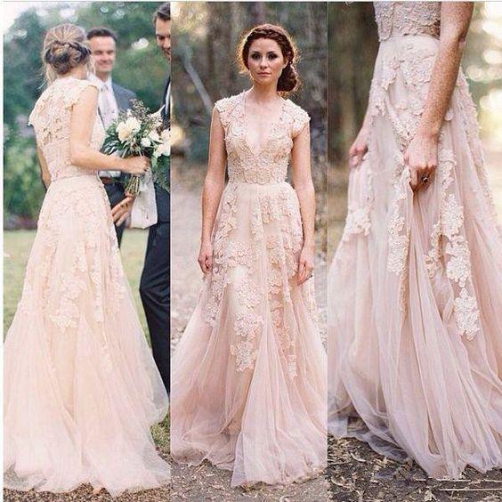 Robe de mariée rose pale longue princesse col en V
