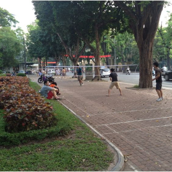 Open badminton games after work and after school on the sidewalks of Hanoi.