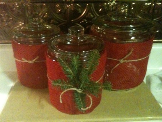 Christmas canisters DIY glass jars cover with burlap tie with jute and add some tree clipping.