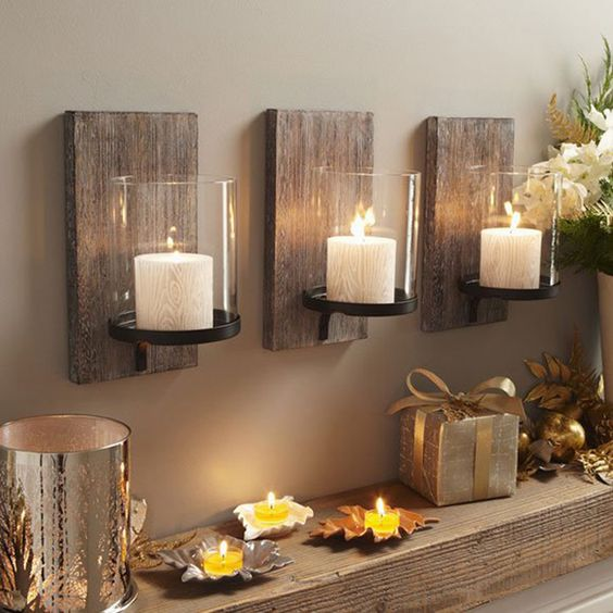 Neat and tidy looking Christmas candle holders. If you are saving space but still want your home to look flashy, you can make do with these wall candle holders. They provide a good place for lighting and can give you more space n the table too.
