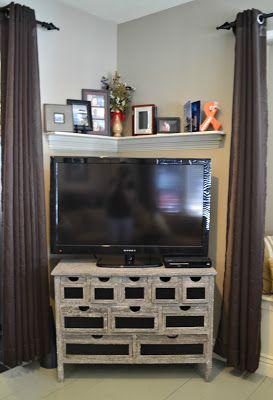 Corner shelf display above tv
