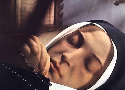 """St Bernadette was born Bernadette Soubirous in Lourdes, France. From February to July 1858, she reported eighteen apparitions of """"a Lady."""" Despite initial skepticism from the Roman Catholic Church, these claims were eventually declared to be worthy of belief after a canonical investigation. After her death, Bernadette's body remained """"incorruptible"""", and the shrine at Lourdes went on to become a major site for pilgrimage, attracting millions of Catholics each year."""