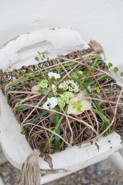 Pillow woven from branches and grasses with flowers