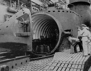 US navy personell examining the aircraft hanger on a captured Sen Toku I-400 class submarine.