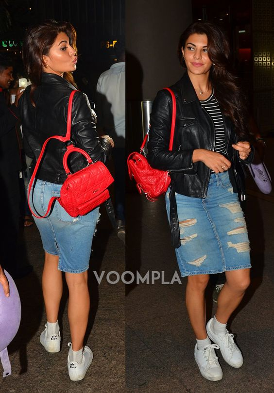 Travel style perfection! Jacqueline Fernandez in denim skirt and black jacket at Mumbai airport. via Voompla.com