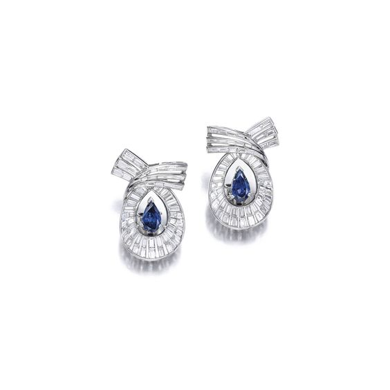 Pair of Sapphire and Diamond Earrings, Tiffany & Co. Of scroll design, each set with a pear-shaped sapphire weighing approximately 2.00 carats in total, accented with tapered-baguette and baguette diamonds weighing approximately 3.00 carats in total, mounted in platinum, signed Tiffany & Co. and numbered.