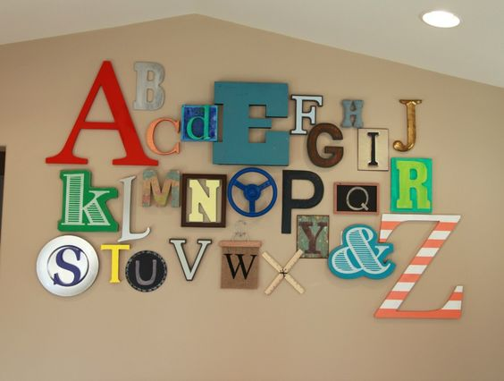 This eclectic, colorful alphabet wall works perfectly for a playroom! #playroom