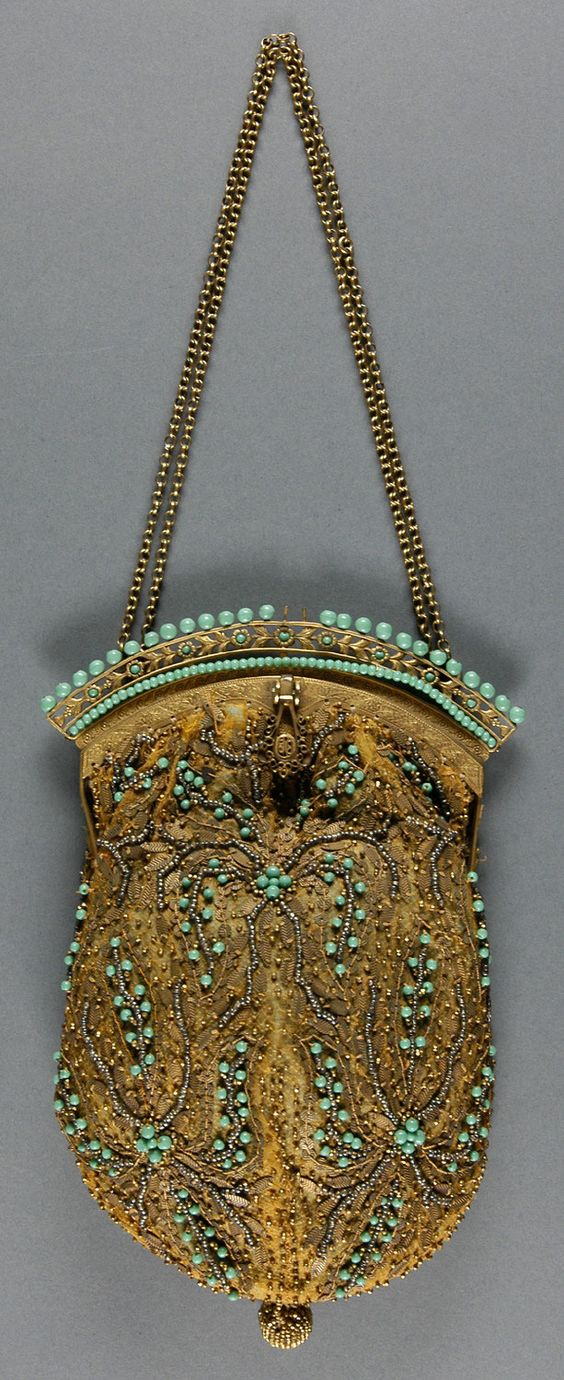 Made in Paris by E. Gauther in early 20th century of gold net and sequins and turquoise beads.