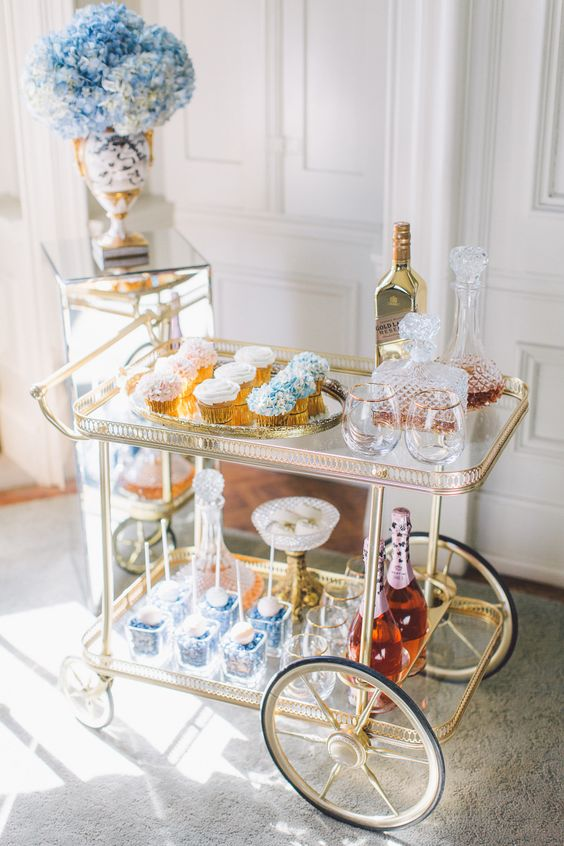 Elegant and creative wedding cocktail idea with a bar cart